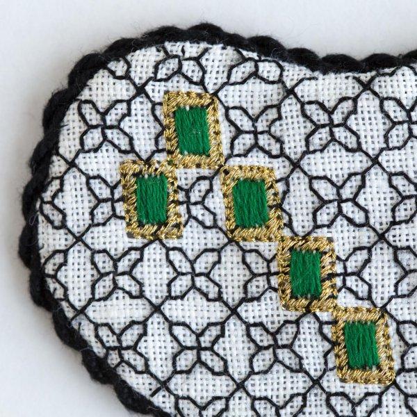 Detail of Blackwork Bejeweled Heart with green gems by Carol Lynn Stratton